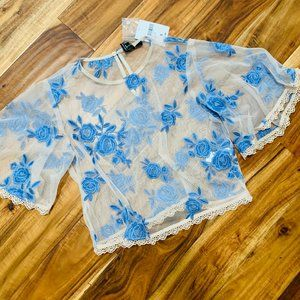 Sheer blouse with blue flower applique